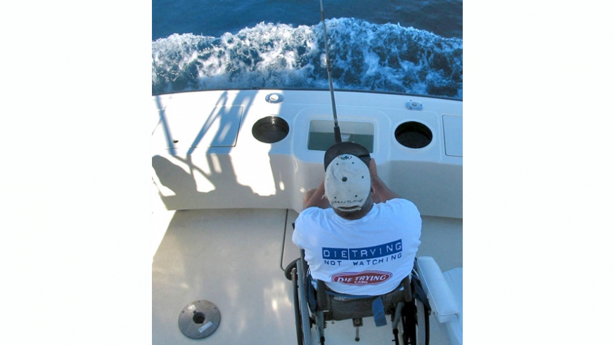 Wheelchair equipped with custom lockdown device to allow angler to remain steady while fighting a fish