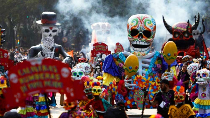 The televised Day of the Dead parade in Mexico City brought an image more familiar to movie watchers