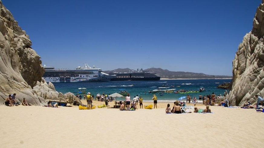 Lover's beach looking toward the bay with the cruise ships in the background